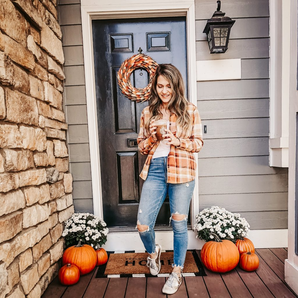 fall outfit with coffee